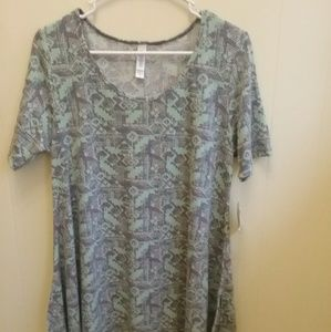 NEW WITH TAGS LULAROE TUNIC. SIZE MEDIUM